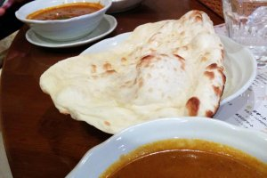 Massive naan bread and your choice of vegetable, chicken, or seafood curry.