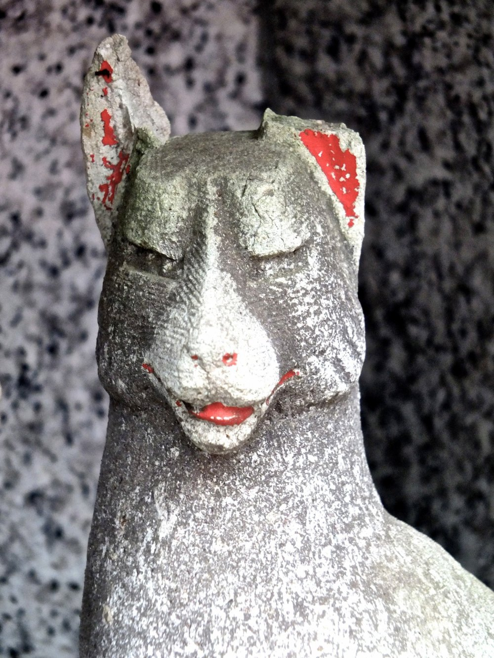 Many of the fox statues have lost their sharp ears; this one now looks likes a llama