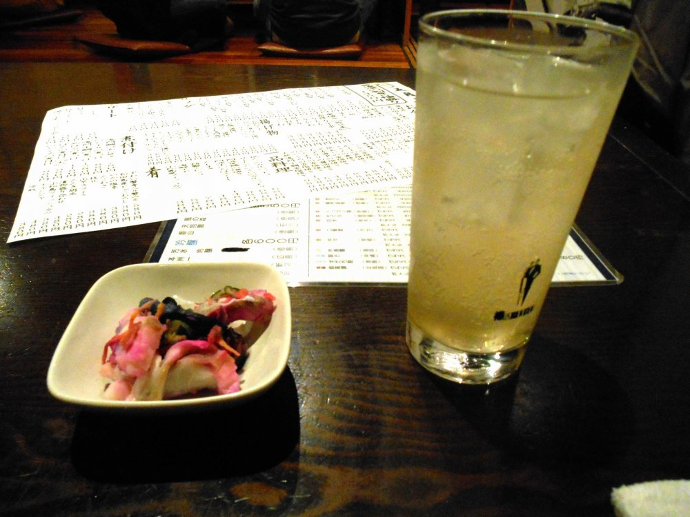 Sudachi Chu-hai (Shochu mixed with soda). Sudachi is one of Tokushima's specialties; green-colored small citrus. They are very expensive when bought outside Tokushima, but here, they are common and you eat it every day. What a luxury!