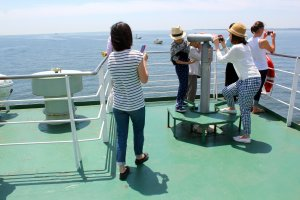 Enjoy the beautiful ocean views and peek through telescopes on the upper deck of the ferry.