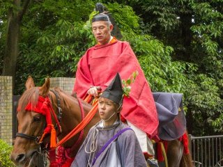 This is the Vice-Governor of Yamashiro (the old name for Kyoto Prefecture) during the Aoi Matsuri procession (葵祭). It's the Yamashiro-Tsukai (山城使)
