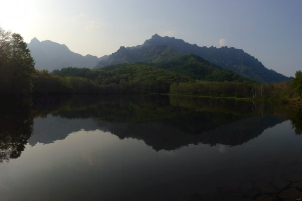 The Togakushi Range, reflected on the still water of Kagami-ike.