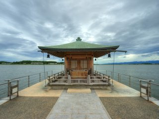 A floating small temple out in the lake