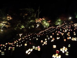 The rows of lanterns remind me of an airport landing strip in the distance.