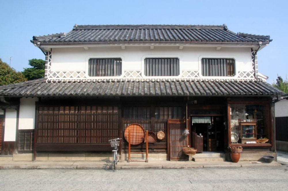 The Bikan district is known for its traditional buildings with their distinctive white walls and black tiles