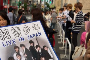 Don't forget to grab a flier from a K-Pop band.