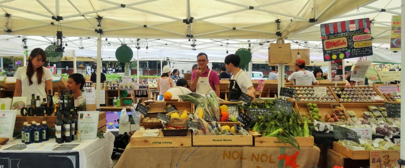Fruit and vegetable vendors at the Farmers' Market in front of Aoyama's UNU
