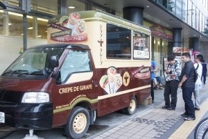 The Giraffe Crepe food truck with a queue of eager costumers