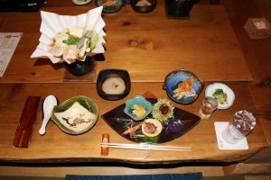 The kaiseki course dinner. Yamato chicken nabe hot pot is in the top left