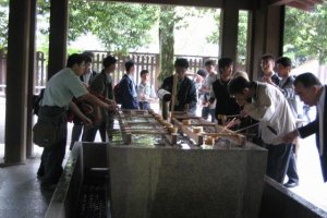 People washing (purifying) before going into the shrine