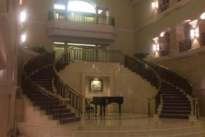The double staircase in the lobby leading up to the guest rooms.