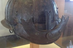A samurai helmet discovered in the mud during excavations