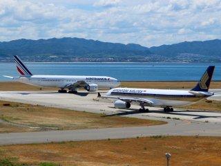 2 planes preparing for take off at Kansai International Airport.
