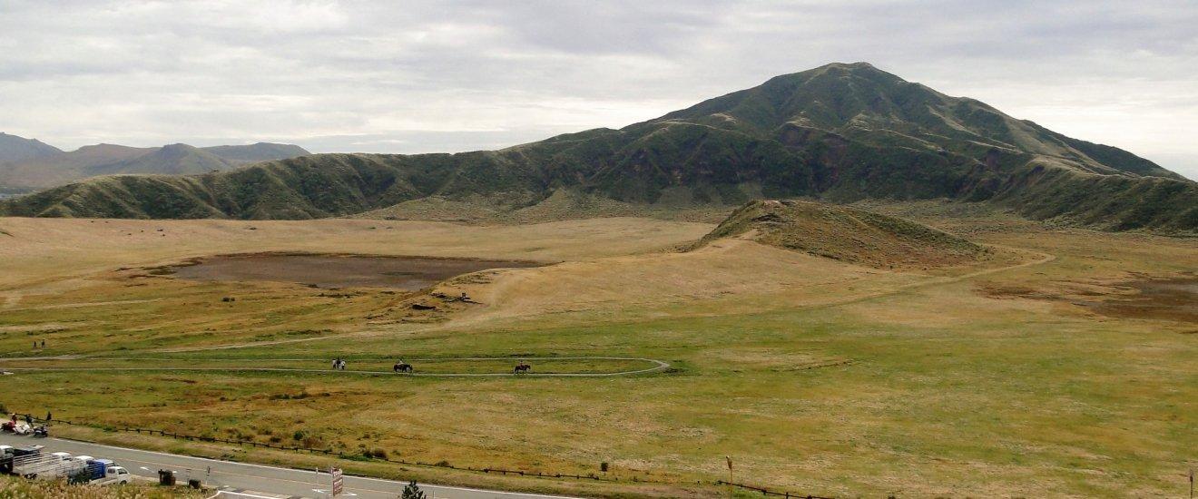 Horses trek across the Kusasenri Plateau