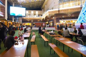 The seating area for people to enjoy the food from the Christmas markets