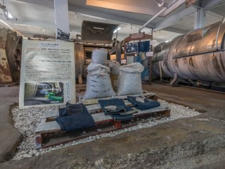 A display inside the jeans museum. The machines on the right are for washing the jeans.