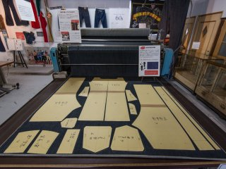 A display at the museum showing how denim is cut to create jeans.