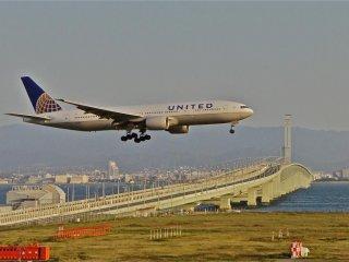 Plane gets in landing position at Kansai International Airport