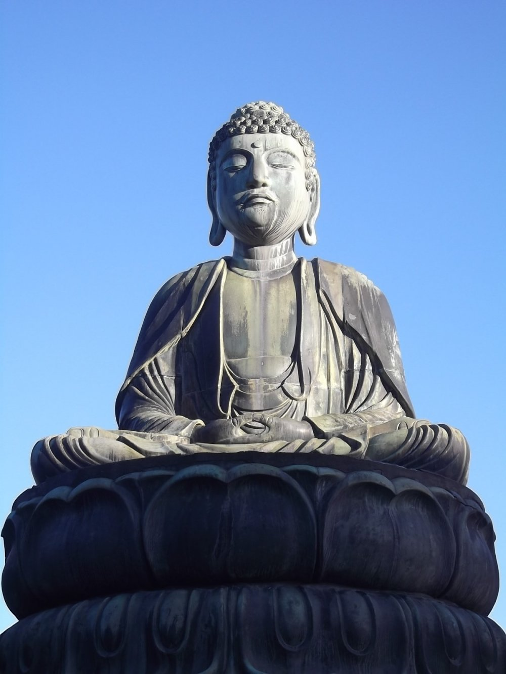 A close-up of the Buddha's serene posture and face