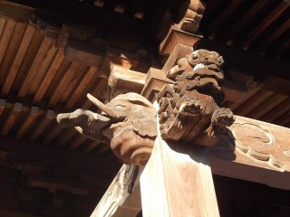 Carved airborne beasts at the worship hall
