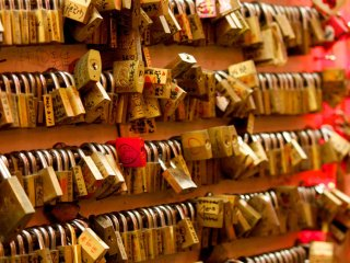 Not quite Paris, but couples leave behind locks on a wall in the Shinsekai area of Osaka.