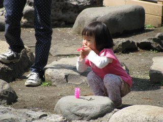 A girl making bubbles