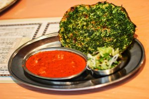 Spinach on both the inside and the outside of the delicious naan