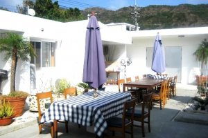 Beautiful Courtyard Tables is a great place to relax day or night at Half Time Pension Dive Shop and Bar at Aharen Beach