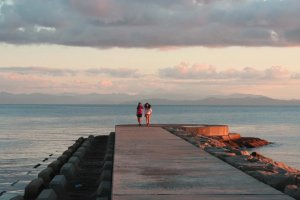 Strolling along a breakwater at sunset.