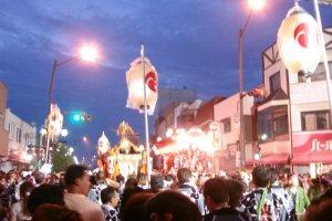 Dusk approaches and festival lights burn