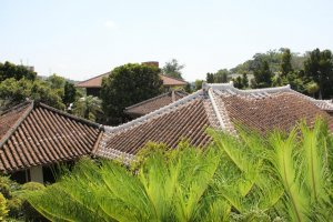 The rooftops of the Nakamura House are decoratively protected by Okinawan red tile.