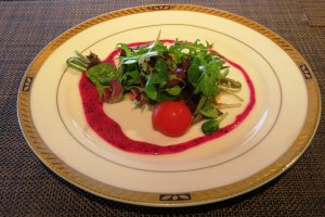 Seasonal-local vegetables with dragon fruits dressing on a classical French plate
