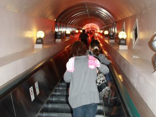 An escalator replaces the endless stairwell at the exit of the 850 meter long cave