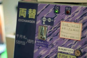 Use the change machine to get more 100 yen coins.