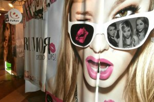 A purikura booth with models on the curtains