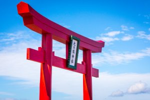 Red torii connects with the blue sky; white clouds create the scene anew with each passing moment