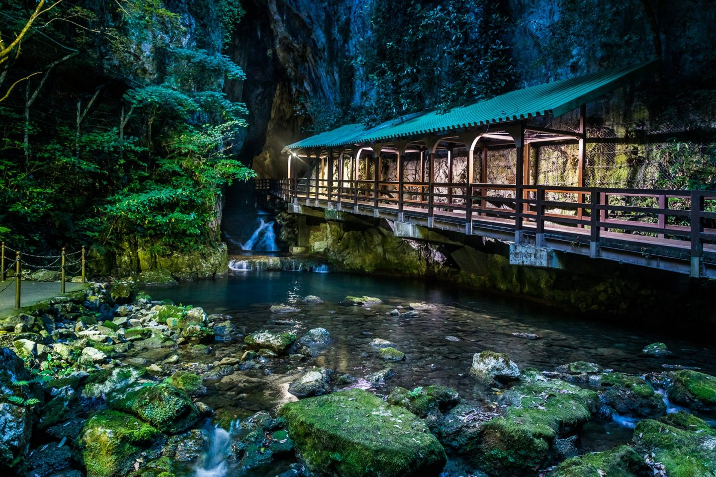 The magical portal bridge of Akiyoshi Cave spans the Ina River and leads you into an underground adventure