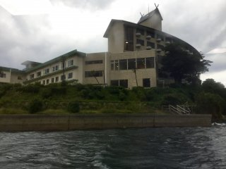 View of the Oki Marine Port Hotel Ama from the water as we pulled into port.