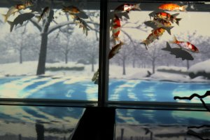 THE FOUR SEASONS AQUARIUM: feauturing a scroll of rotating seasonal images serving as a backdrop for the swimming goldfish.