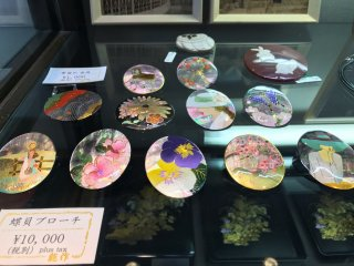 Intricate, colorful brooches