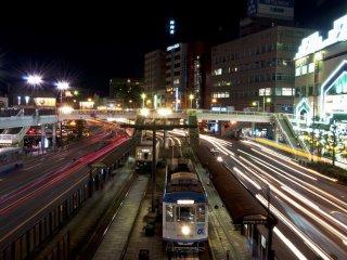 Light trails of the traffic passing on both sides of Nagasaki-Ekimae station at night