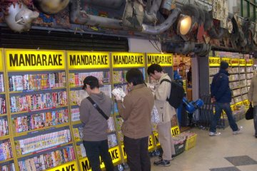<p>Are you going to buy that? Browsers at Mandarake&#39;s main comics store</p>