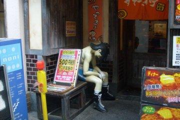 <p>Still waiting: hogging a seat outside a restaurant on Furea Road</p>
