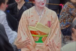 One of the lovely geisha girls patiently waiting to dance at one of the hanami parties