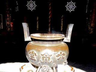 Incense burner in front of the alter
