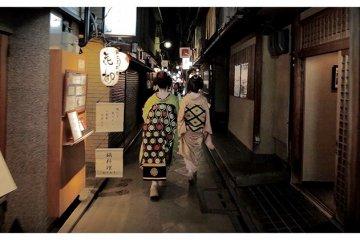 <p>Two Maikos&nbsp;Walking Down&nbsp;Pontocho, Kyoto, Japan</p>