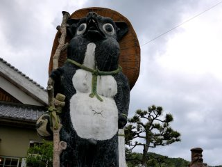 This tanuki looks ready to set off on a journey