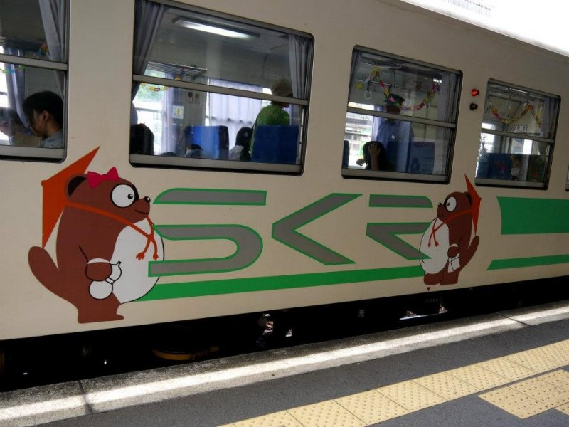 <p>The small local train is decorated with tanuki</p>