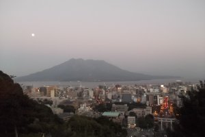A dusk view from Shiroyama as the city'slights start to come on