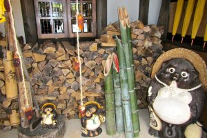 Stacked wood for the fire places and traditional cut bamboo and tanuki statues keep the Japanese countryside mood.